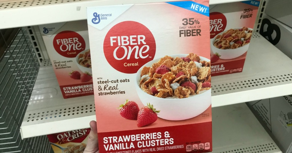 Woman holding Fiber One Strawberries Cereal at dollar Tree