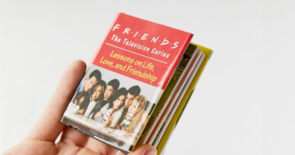 hand holding tiny friends book