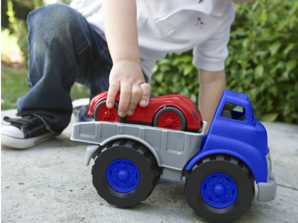Boy playing with Green Toys Flatbed Race Set
