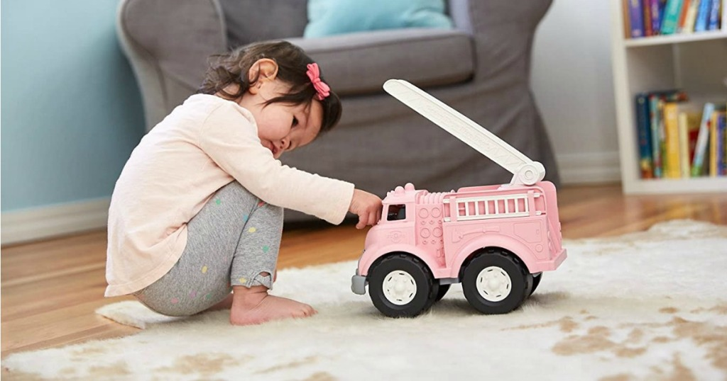 Girl playing with Green Toys Pink Firetruck
