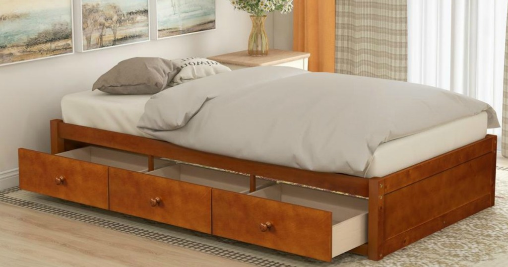 bed with open drawers underneath