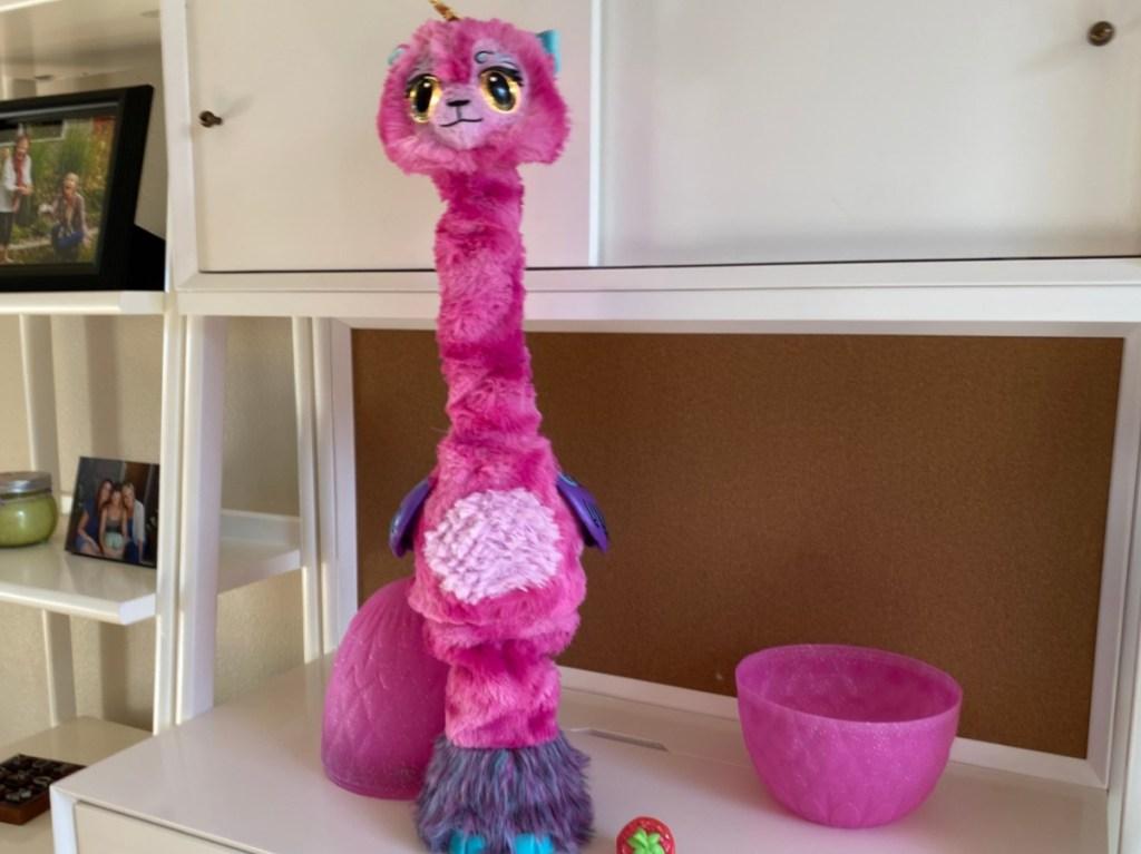 pink llama unicorn hatching toy on counter
