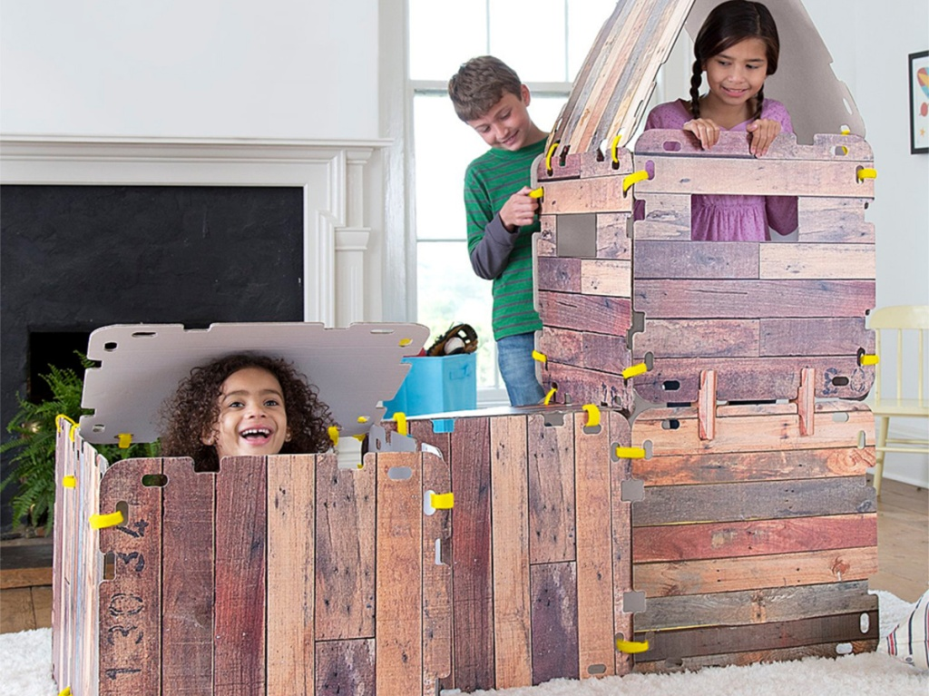 children inside wood play fort inside home