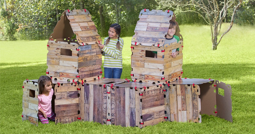 children inside wood play fort outside