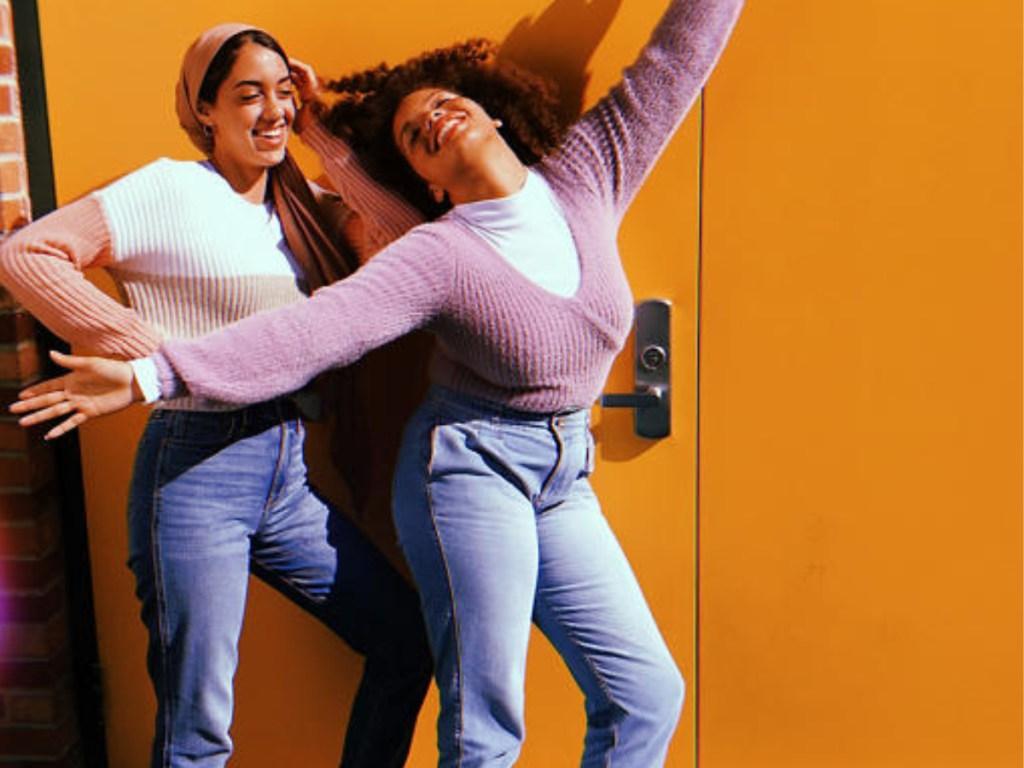 women wearing sweatshirts and jeans