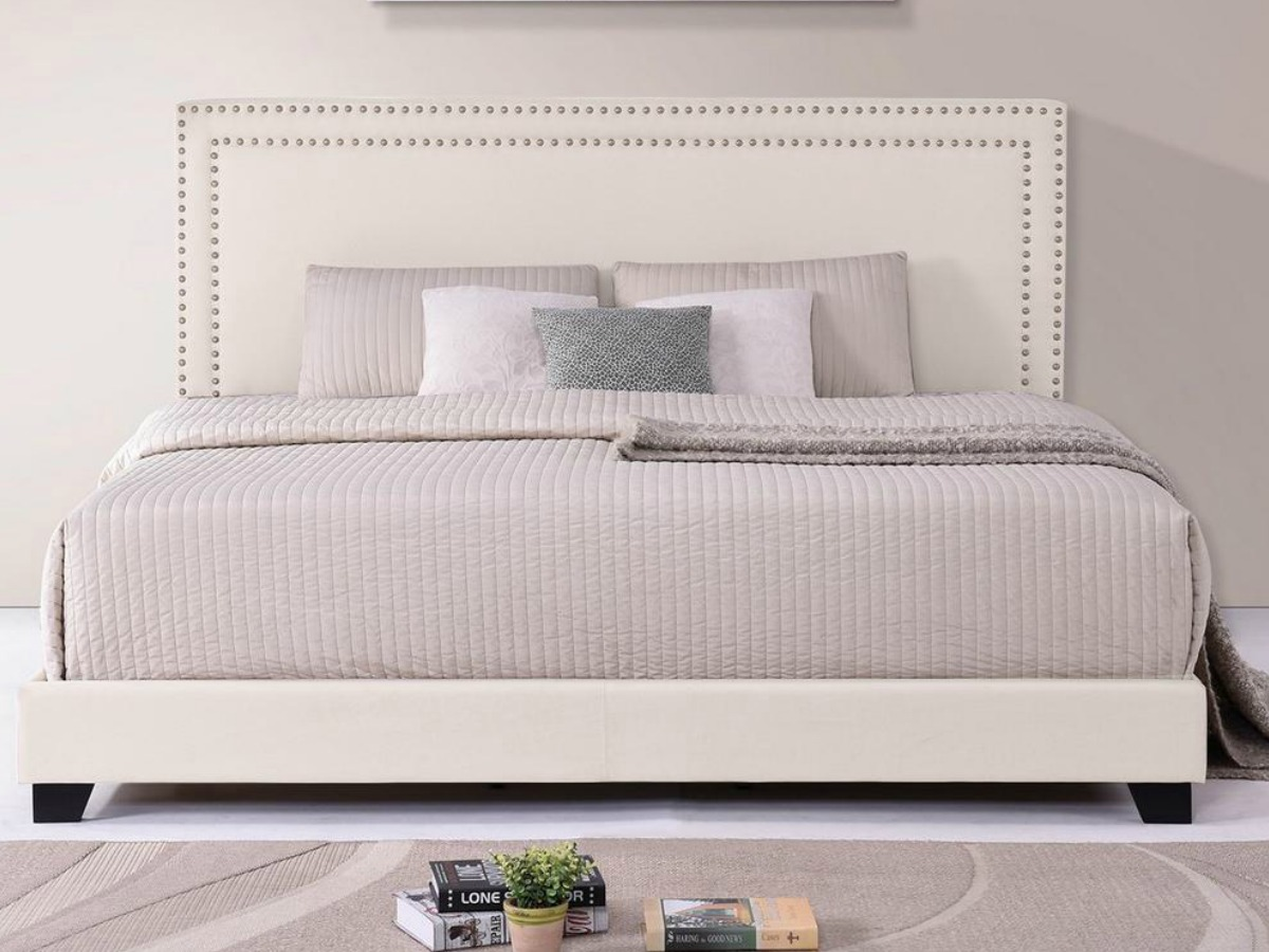 Large king size bed with fabric headboard