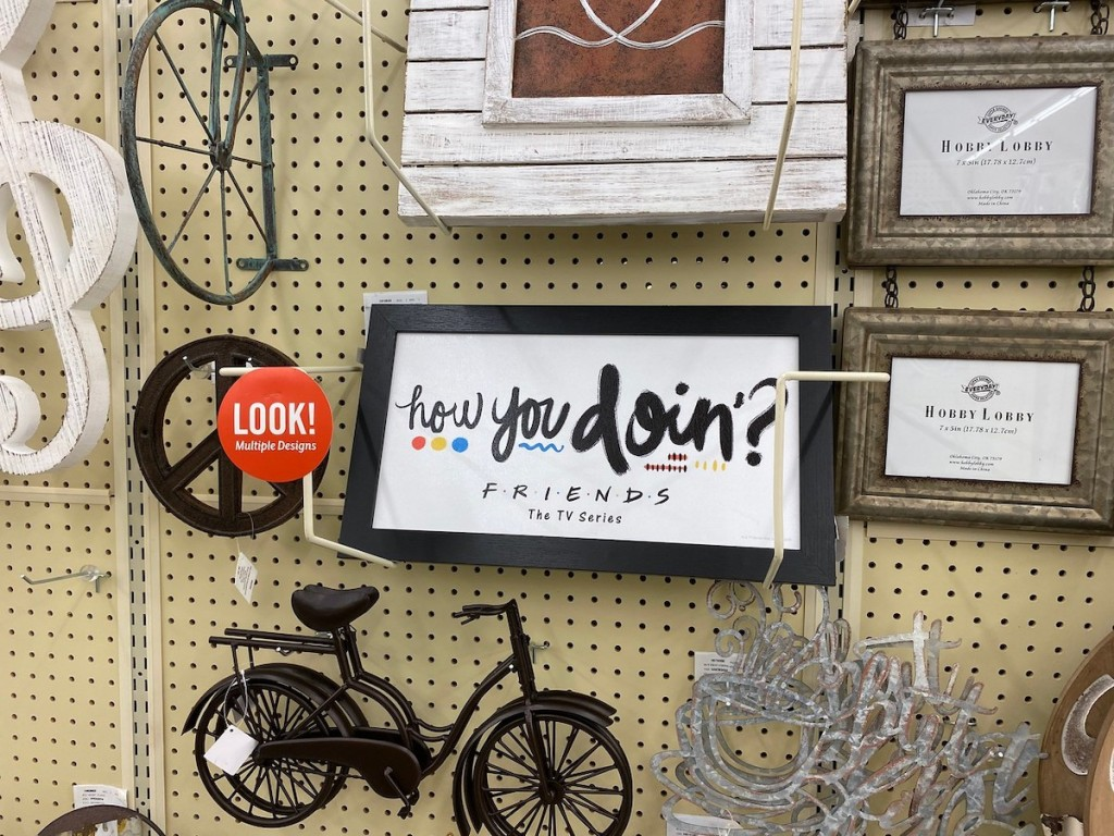 wall of decor at hobby lobby including friends how you doin