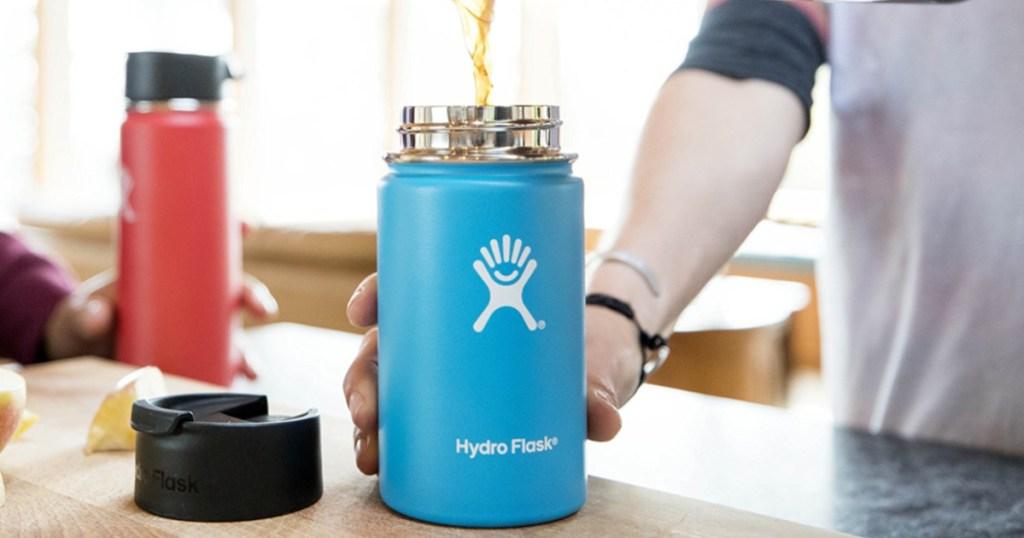 man pouring coffee into 16 oz hydro flask coffee flask