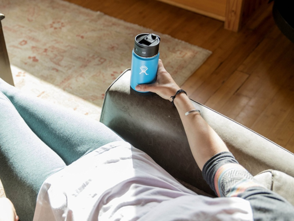 Woman sitting in chair holding 16 oz coffee Hydro Flask