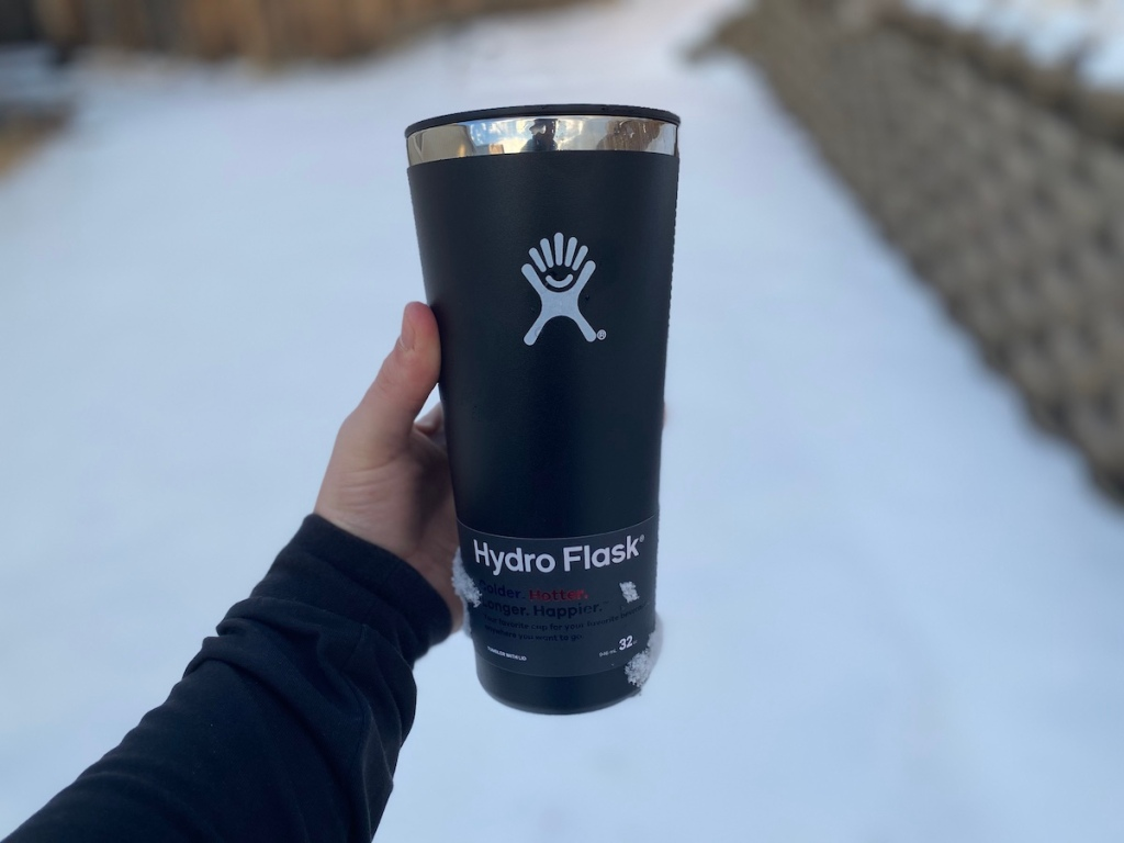 hand holding a hydro flask tumbler