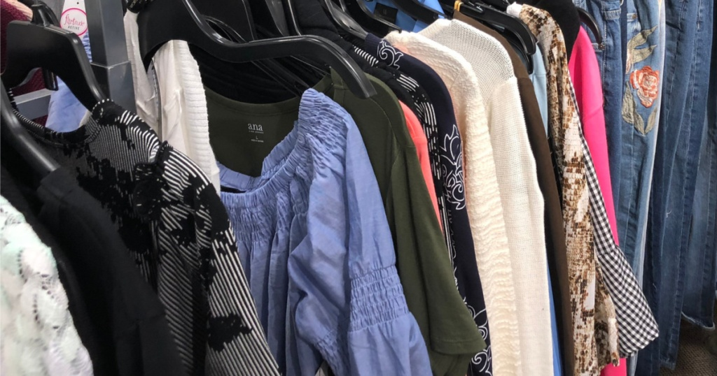women's clothing hanging on rack in store