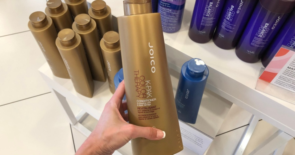 hand holding JOICO K-PAK Conditioner in store
