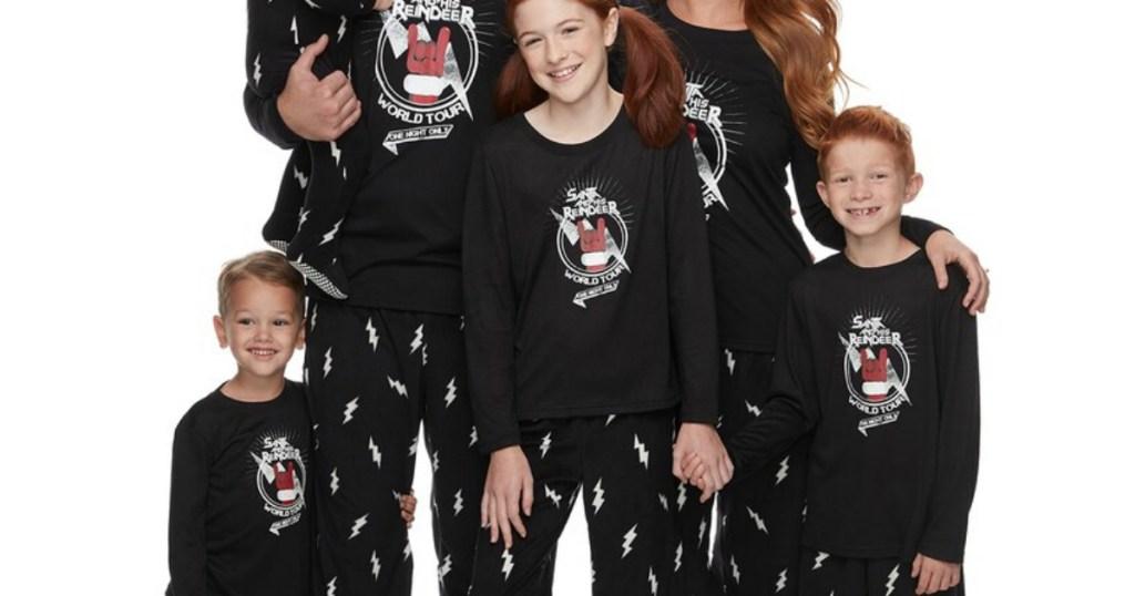 family wearing matching Christmas pajamas