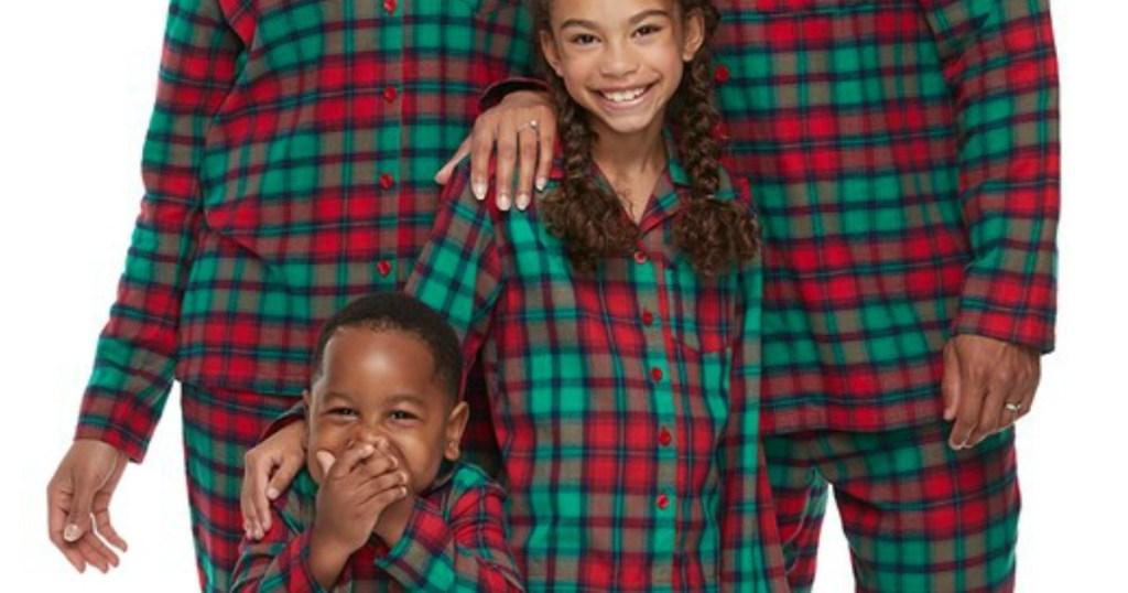 family wearing matching plaid pajamas