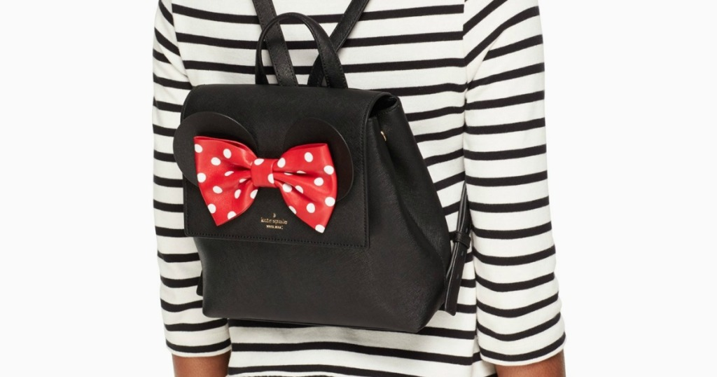 woman wearing a Minnie Mouse backpack