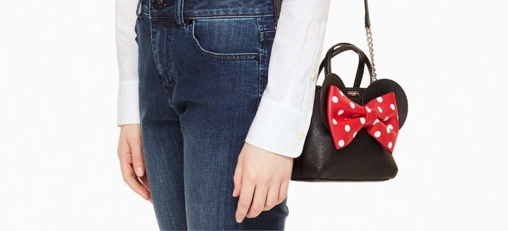 person carrying a Minnie Mouse bag