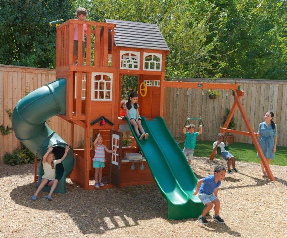 kids playing on a KidKraft Copper Ridge swingset