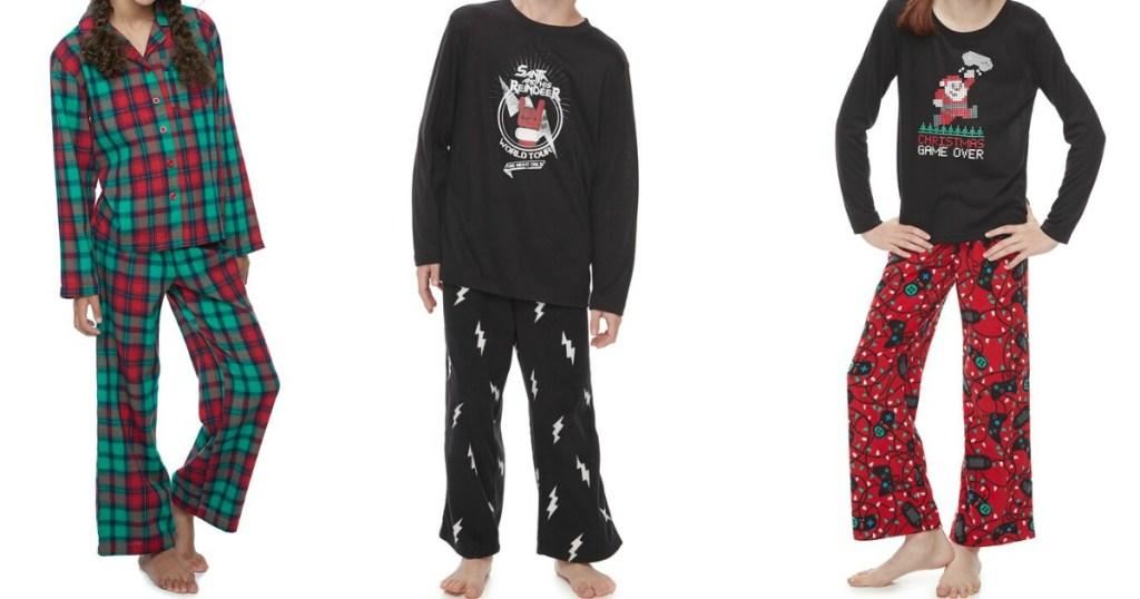 three kids wearing Christmas pajamas