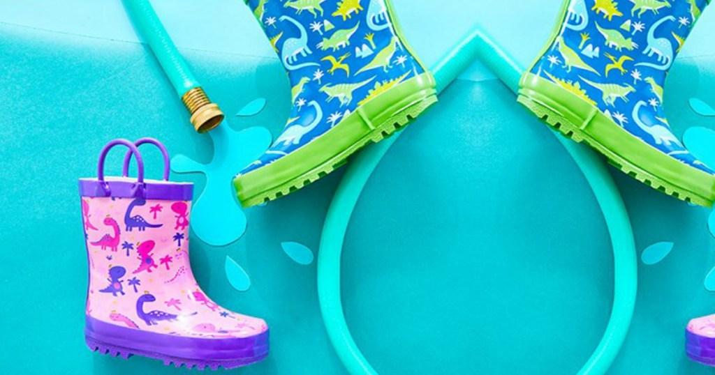 kids rain boots next to hose