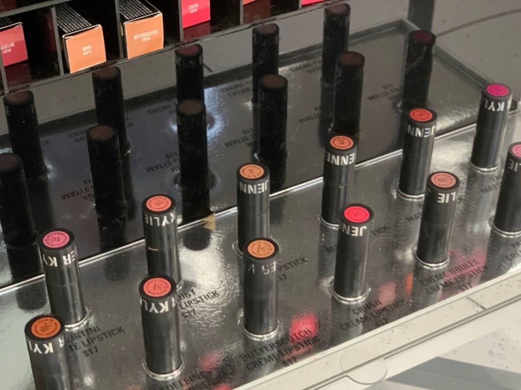 lipsticks standing in display in makeup store