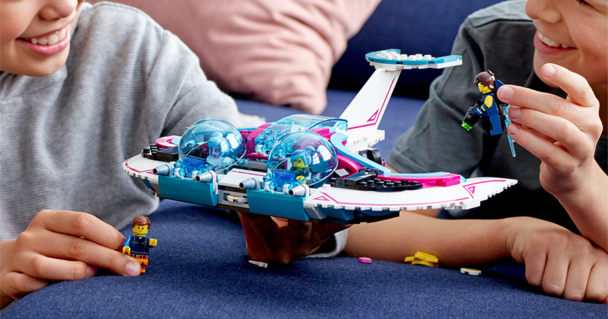 kids playing with LEGO spaceship