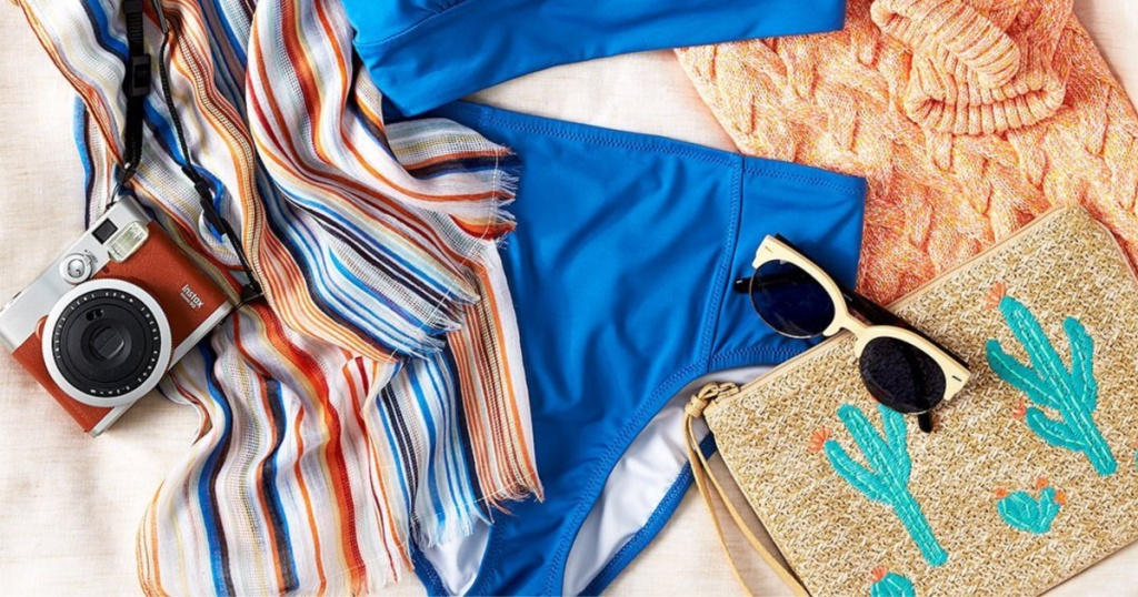 blue swimsuit, camera, sunglasses, and other clothing and accessories