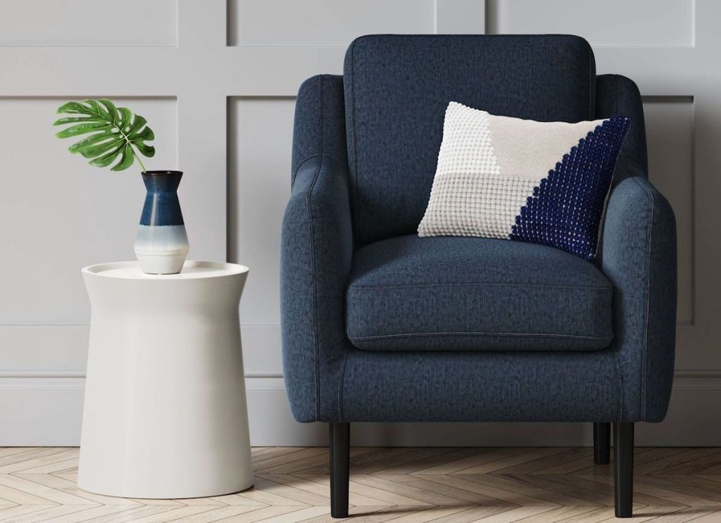 room with side table and blue accent chair
