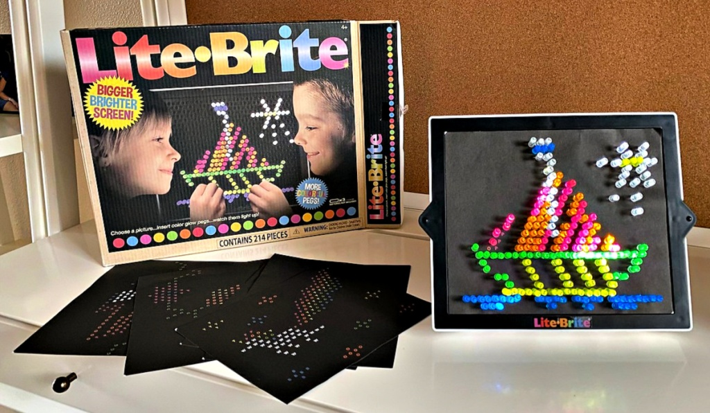 Lite Brite toy on table with contents shown