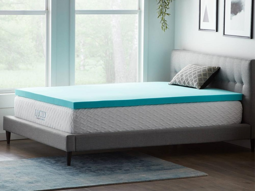 lucid white mattress with blue topper in bedroom