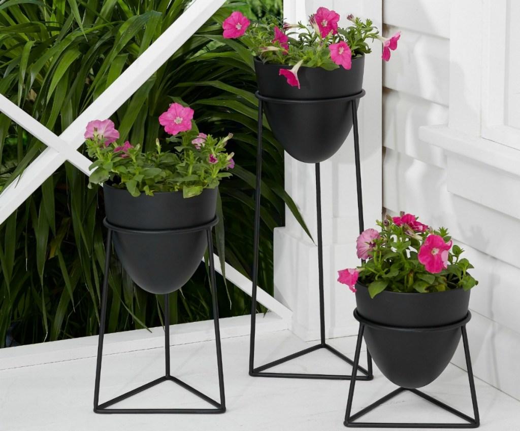 set of 3 dark metal planters full of flowers