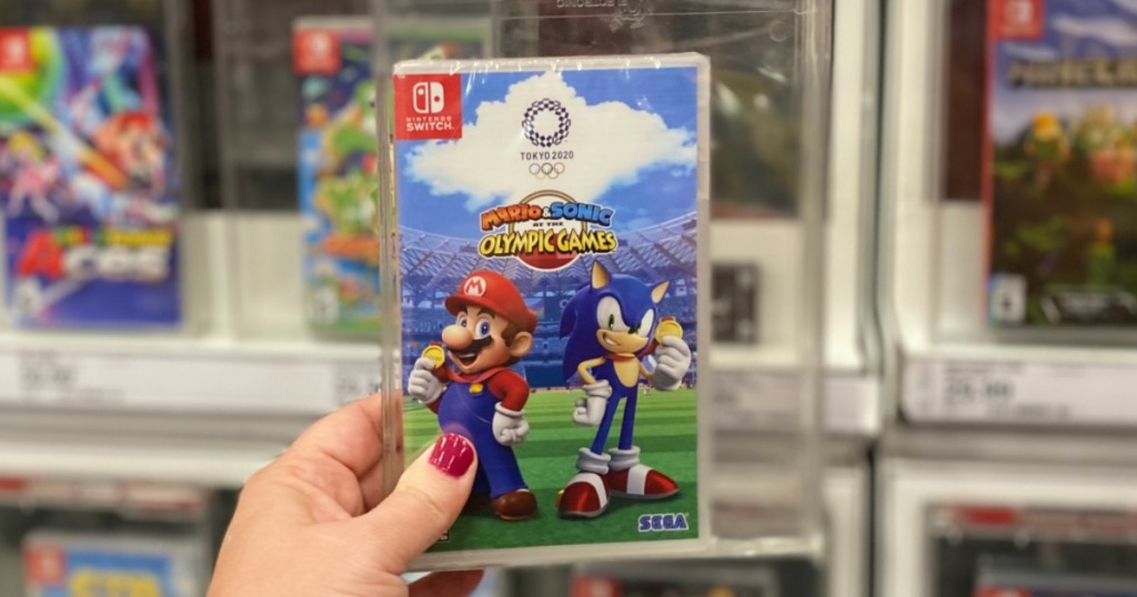 hand holding the Mario & Sonic Olympic Games game