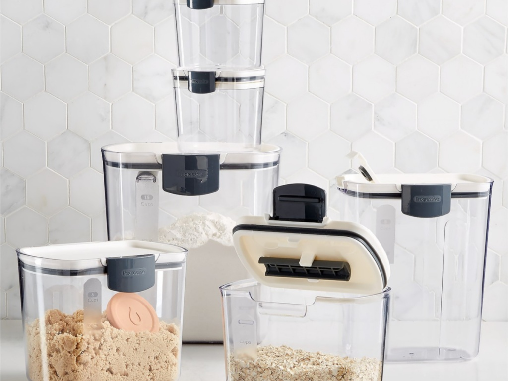 sugar, oats, and flour in storage containers on counter