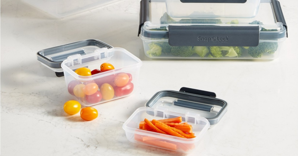 carrots, grape tomatoes, and broccoli in food storage containers on counter