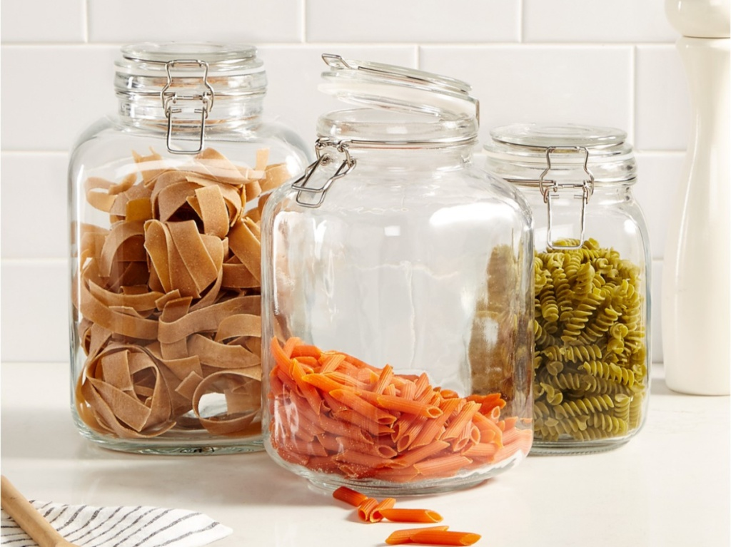 dry pastas in food canisters on kitchen counter