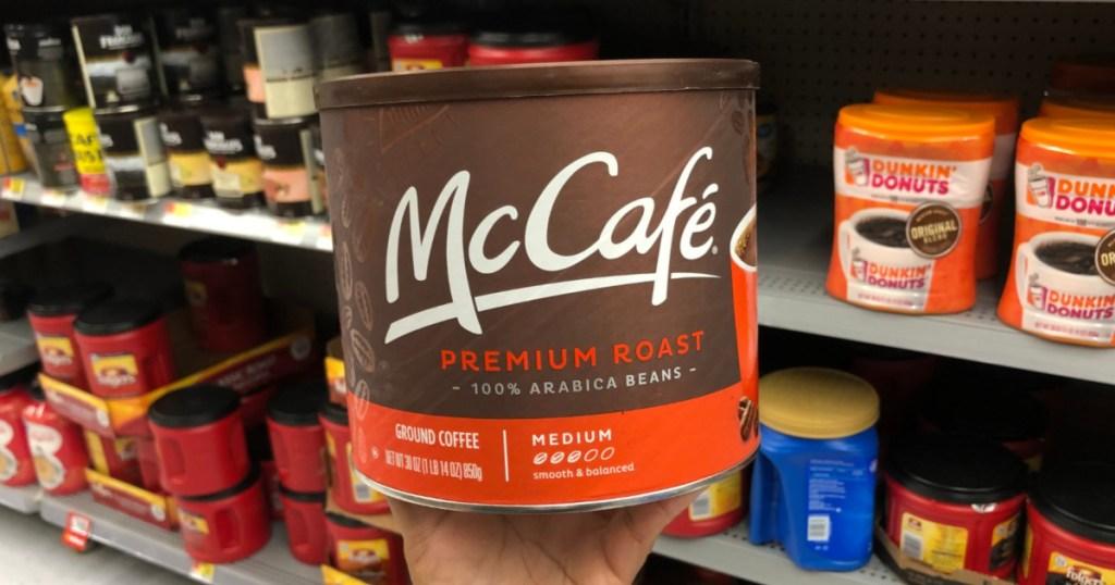 Hand holding McCafe Ground Coffee