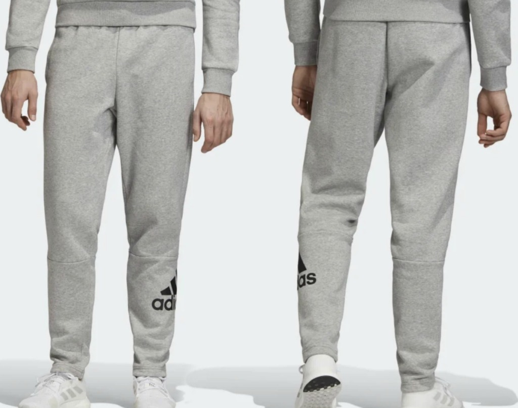 Man wearing gray sweat pants with matching hoodie - front and back view