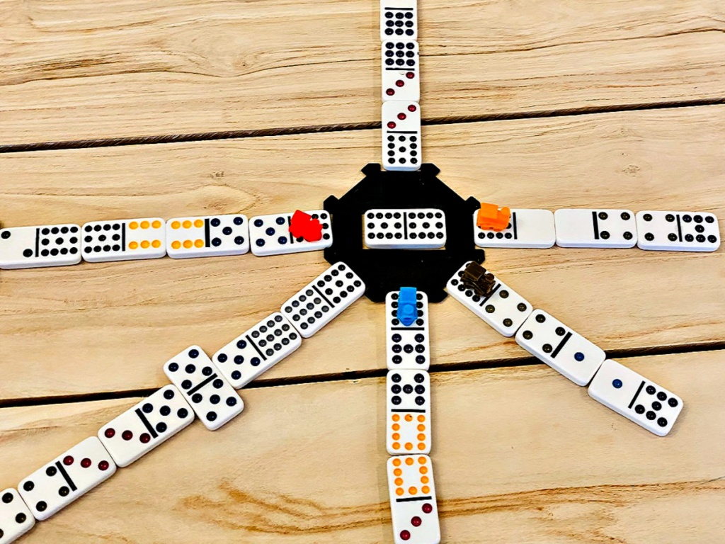Mexican Train Domino Game in play on wood table