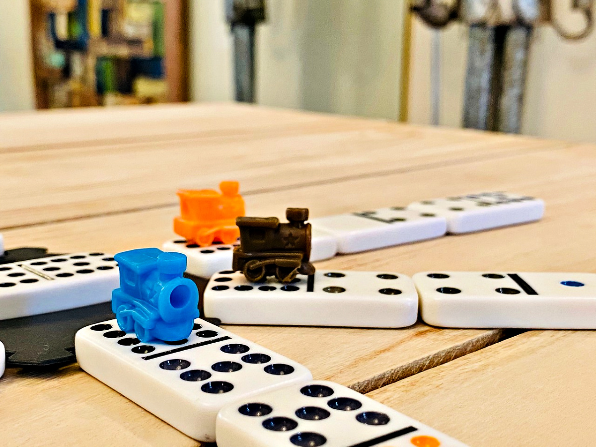 Mexican Train Domino Game with trains on tiles