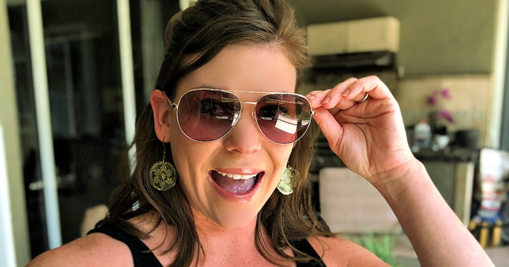 woman wearing Michael Kors Rodinara Aviator Sunglasses