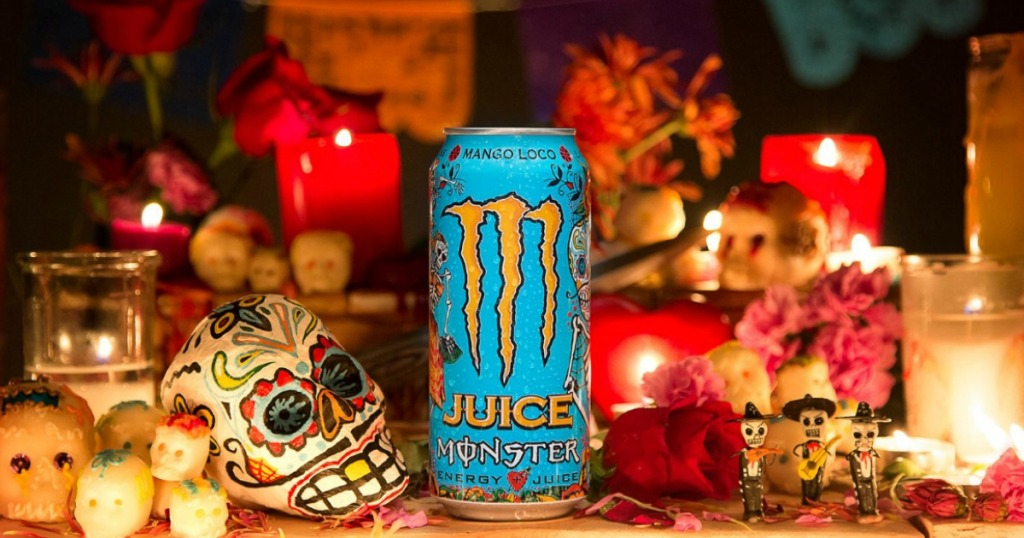 Monster Energy Juice Monster Mango Loco, Energy + Juice can surrounded by Day of the Dead decorations