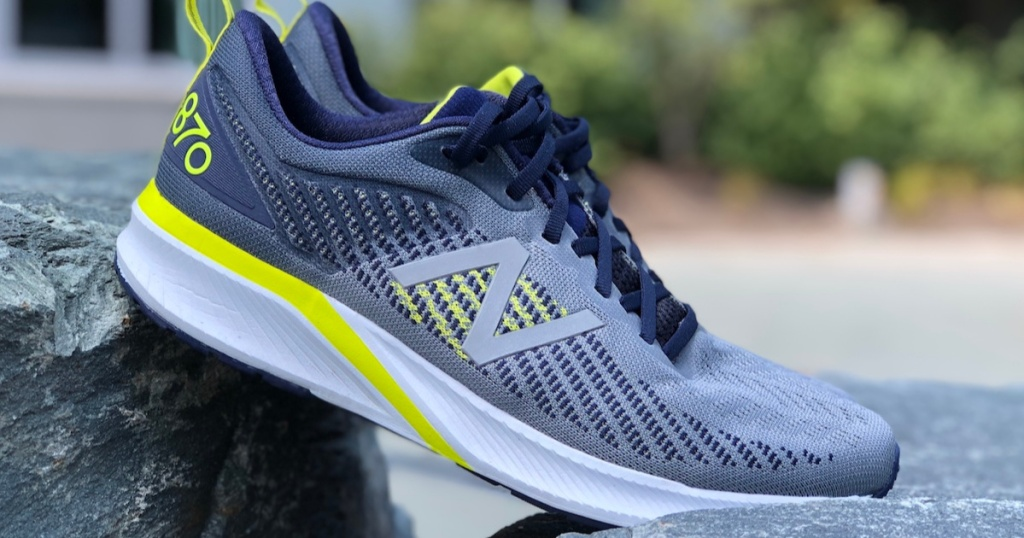men's grey and yellow running shoe