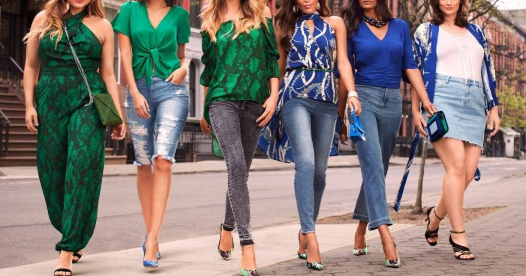 six women dreshed in fashionable clothes walking on sidewalk in New York City