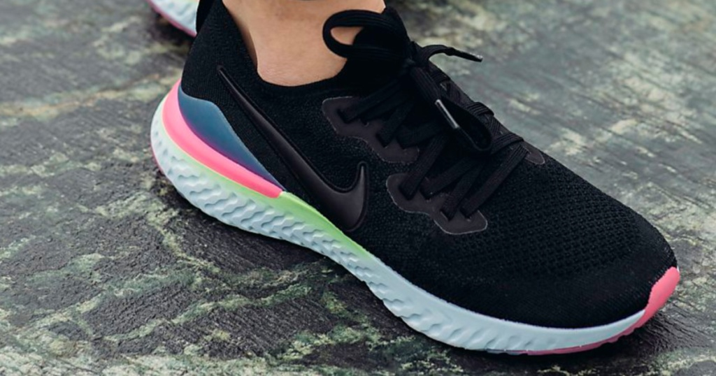 black nikes with white sole and purple pink and green accents