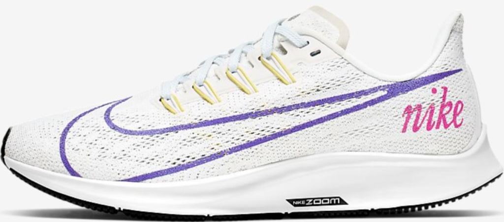 white nike shoes with purple logo and pink nike