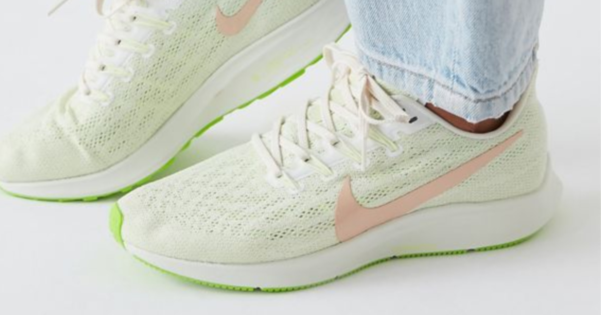 women wearing green and pink nike shoes