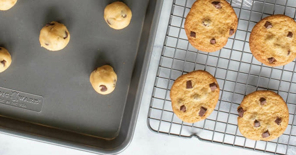 cookies on a baking sheet and a cooling rack