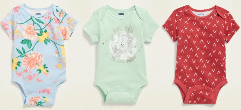 three baby bodysuits
