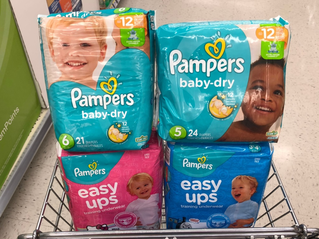 four diaper packages in cart in store aisle