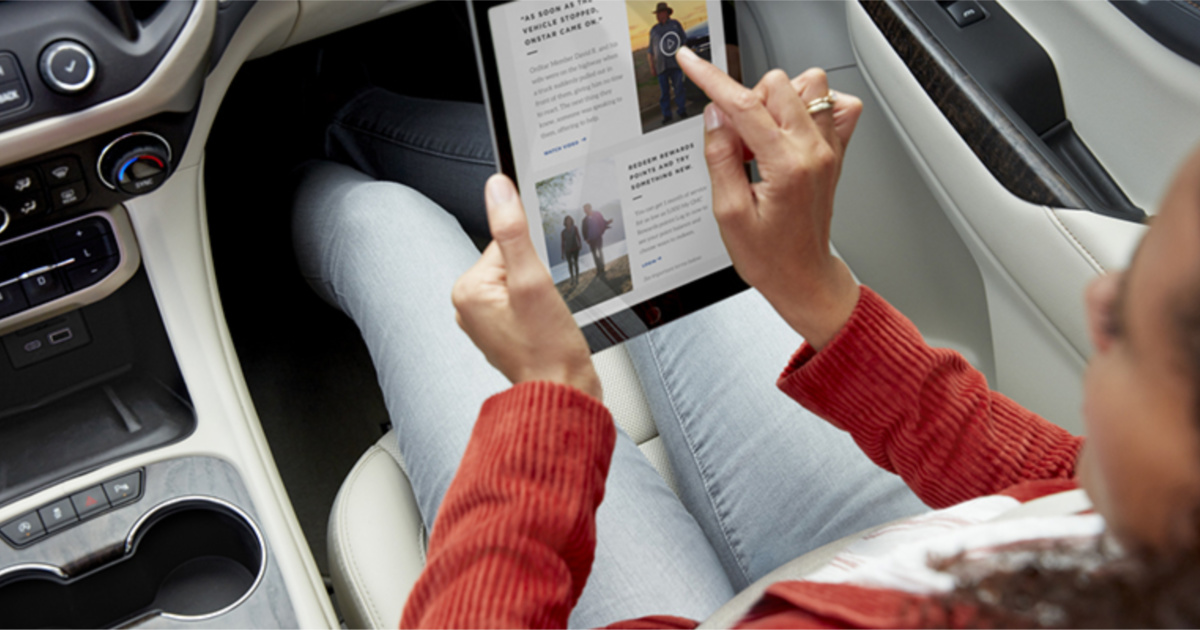 woman in car on her tablet