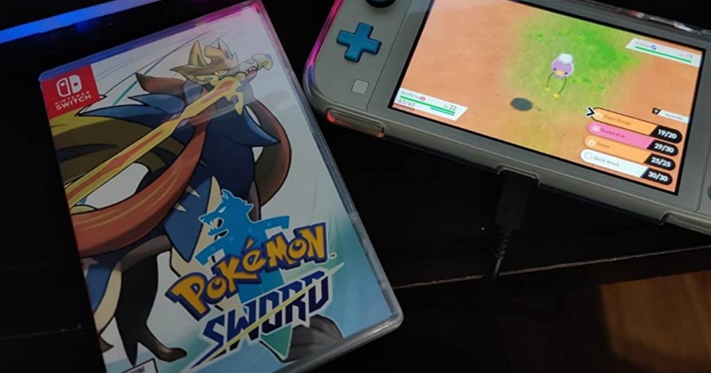 Pokemon game next to a Nintendo Switch